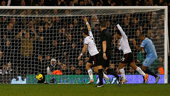 Vincent Kompany puts the ball into his own net against Fulham.
