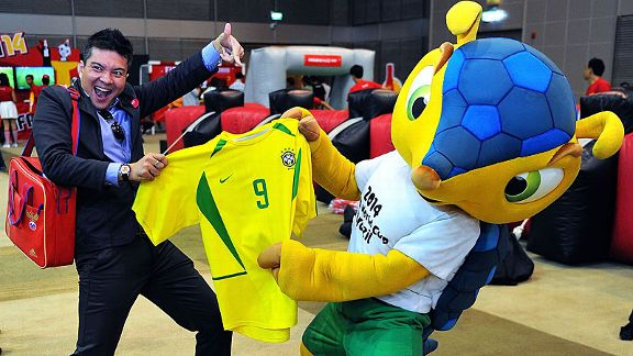 The mascot of the FIFA Brazil 2014 World Cup, Fuleco, poses during the FIFA World Cup trophy tour