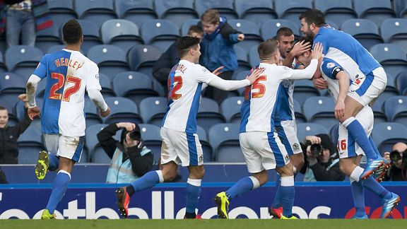 Blackburn players go wild after Scott Dann produced a shock leveller against Manchester City.