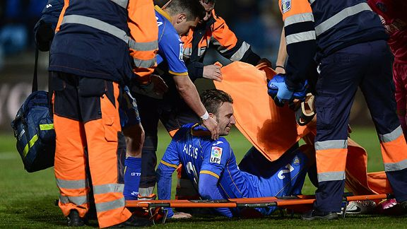 Getafe defender Alexis Ruano Delgado is helped onto a stretcher.
