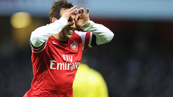 Santi Cazorla celebrates after netting his second against Fulham.