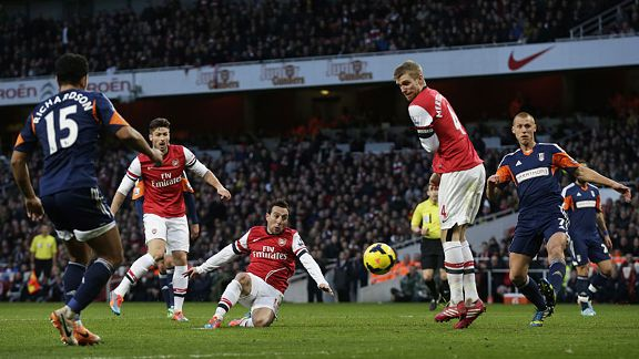 Santi Cazorla scores his first goal against Fulham.
