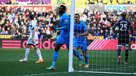 Emmanuel Adebayor celebrates after breaking the deadlock at Swansea.