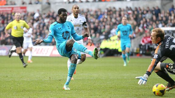 Emmanuel Adebayor scores his second, and Spurs' third, against Swansea.