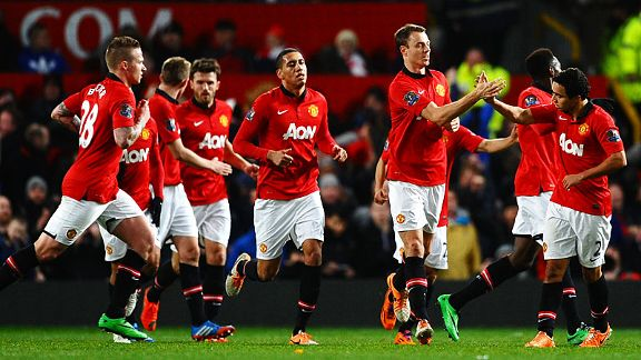 Man United celebrate Jonny Evans' goal.