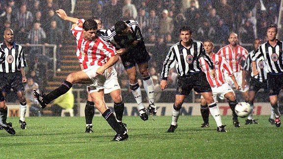 Sunderland's Niall Quinn swoops to score against Newcastle.