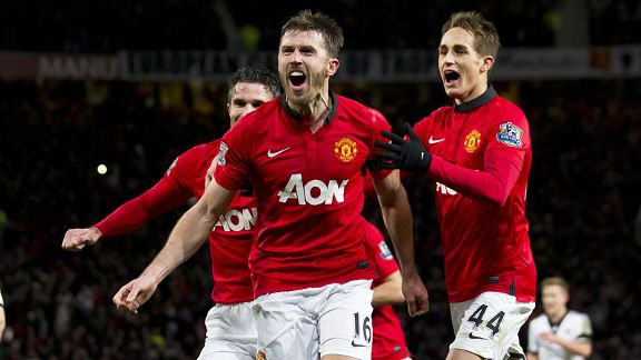 Man United celebrate Michael Carrick's goal which appeared to have given them a 2-1 win over Fulham.