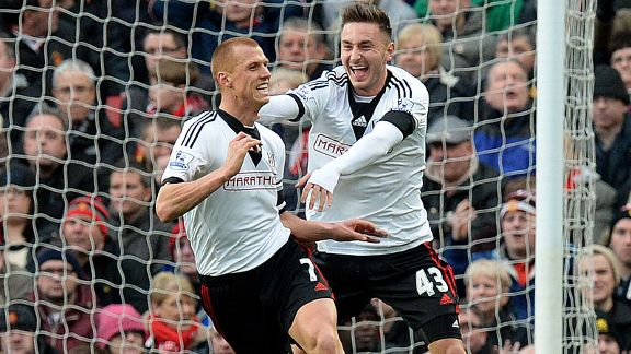 Goalscorer Steven Sidwell celebrates with Muamer Tankovic after putting Fulham in front at Man United.