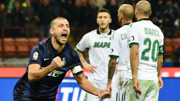 Walter Samuel celebrates after netting Inter's winner against Sassuolo.