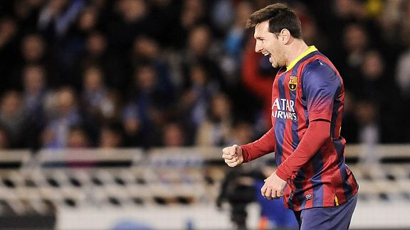 Lionel Messi celebrates after putting Barcelona in front against Real Sociedad.