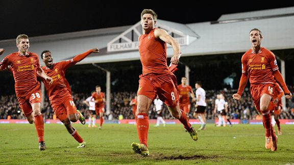Liverpool celebrate after Steven Gerrard scored their late, late winner at Fulham from the penalty spot.