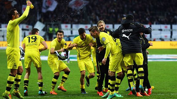 Borussia Dortmund celebrate their hard-earned cup win at Eintracht Frankfurt on Tuesday.