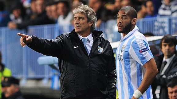 Manuel Pellegrini gives instructions to Oguchi Onyewu before he comes on for Malaga last season.
