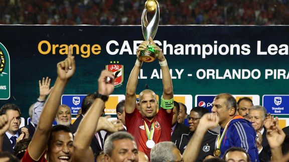 Al Ahly's Wael Gomaa lifts the 2013 CAF Champions League trophy.
