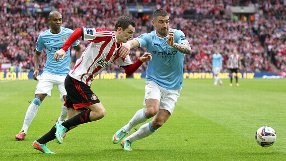 Adam Johnson and Aleksandar Kolarov go toe-to-toe.
