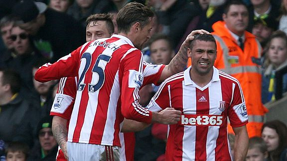 Stoke celebrate after Jonathan Walters levelled from the spot at Norwich City.