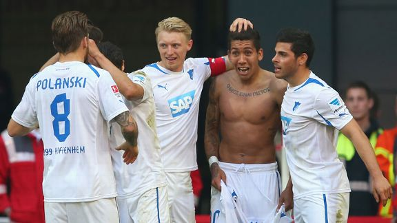 Roberto Firmino celebrates with his Hoffenheim teammates after scoring the goal that secured a point against Bayern Munich.