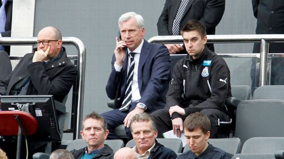 Alan Pardew watches on from the stands during his side's defeat to Manchester United.