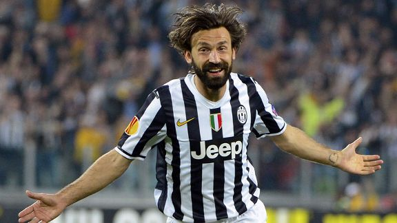 Andrea Pirlo celebrates after scoring an early free kick against Lyon.
