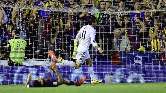 Gareth Bale celebrates after netting the winning goal for Real Madrid.