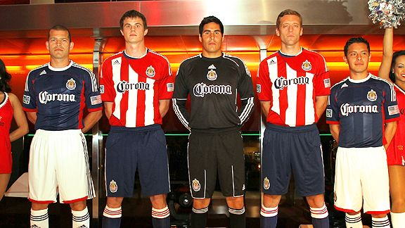 Chivas USA players on stage unveiling their new jersey.