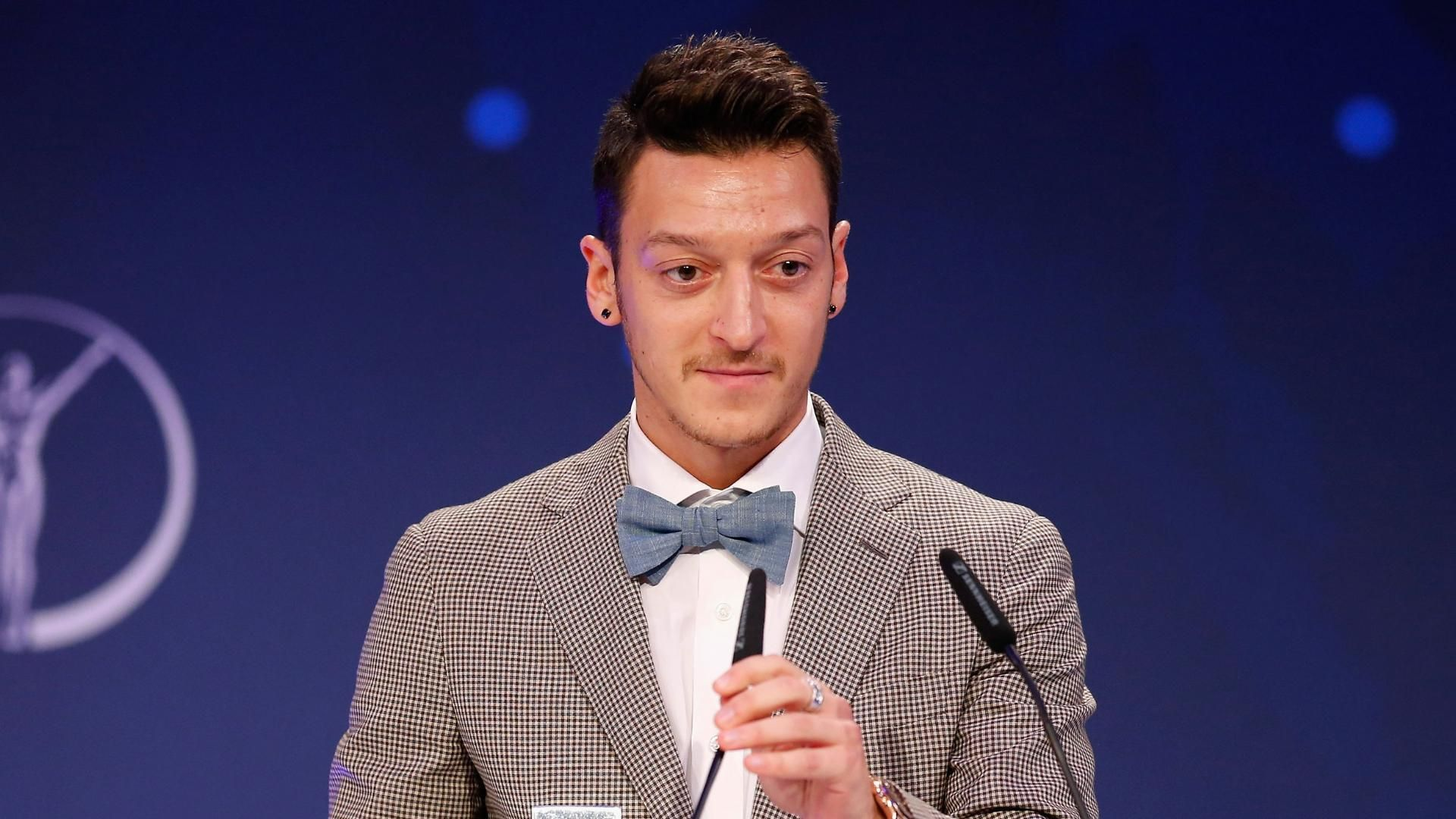 Mesut ozil received a prize for charity at the laureus media awards on