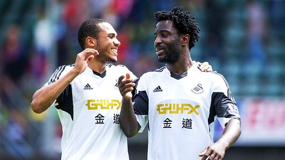 New Swansea teammates Kenji Gorre and Wilfried Bony had much to smile about during the 1-0 win over ADO Den Haag Saturday.