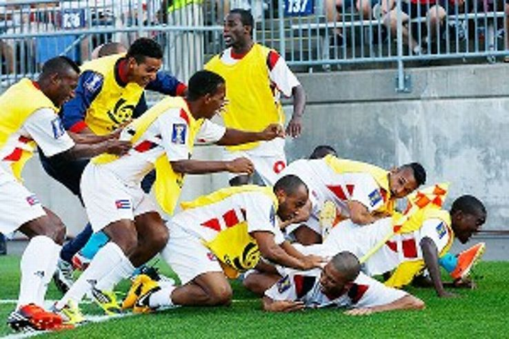 Cuba players celebrate after scoring their crucial fourth goal of Tuesday's game.