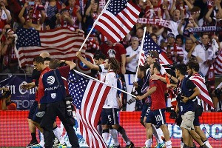 Jubiliant U.S. players celebrate the 2-0 Mexico win that propelled the U.S. to its seventh straight World Cup berth.