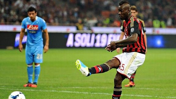 Mario Balotelli misfires on a penalty kick against Napoli. Balotelli scored a late consolation goal, but a post-game red card will make him miss Wednesday's game at Bologna.
