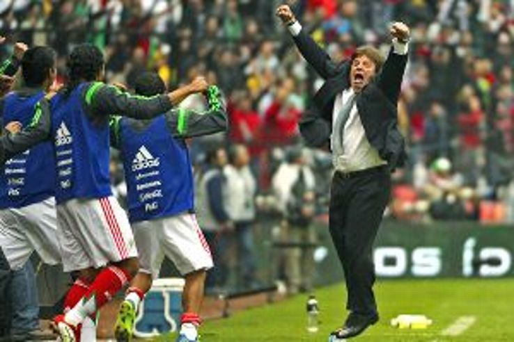 Miguel Herrera celebrates one of Mexico's goals against New Zealand.