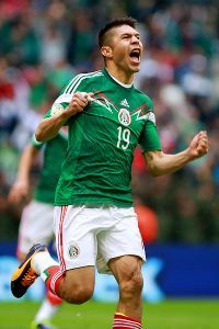 Oribe Peralta celebrates one of his two goals in Mexico's 5-1 win over New Zealand.