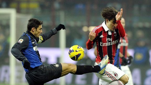 Former AC Milan player Bojan Krkic, right, battles Inter's Javier Zanetti for the ball in last February's derby.
