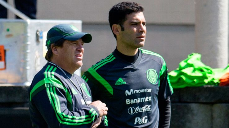 There is still some thought that Mexico head coach Miguel Herrera, left, could call in veteran defender Rafael Marquez.