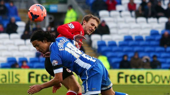Cardiff City were beaten by lower-level Wigan 2-1.