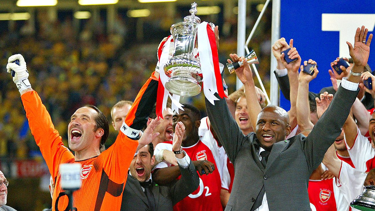 David Seaman, left, lifts the FA Cup trophy alongside Patrick Vieira in 2003.