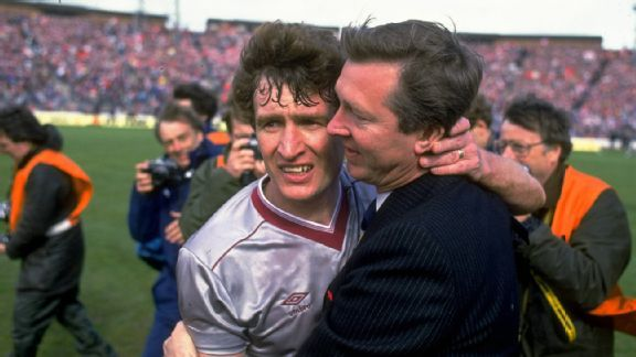 Alex Ferguson (right), manager of Aberdeen hugs Sandy Jardine of Hearts in commiseration after the Scottish Cup Final match at Hampden Park in Glasgow, Scotland. Aberdeen won the match 3-0.