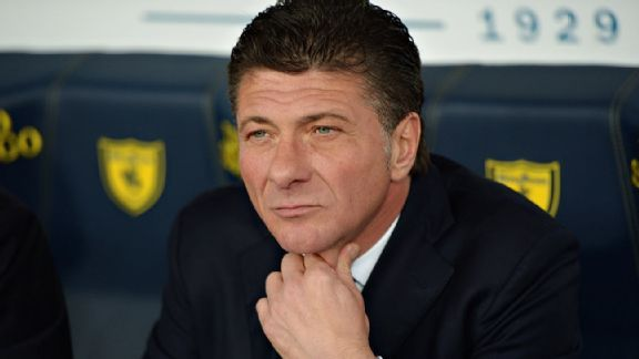 Inter Milan manager Walter Mazzarri must be pondering next year as he watches his side lose their final match to AC Chievo Verona.