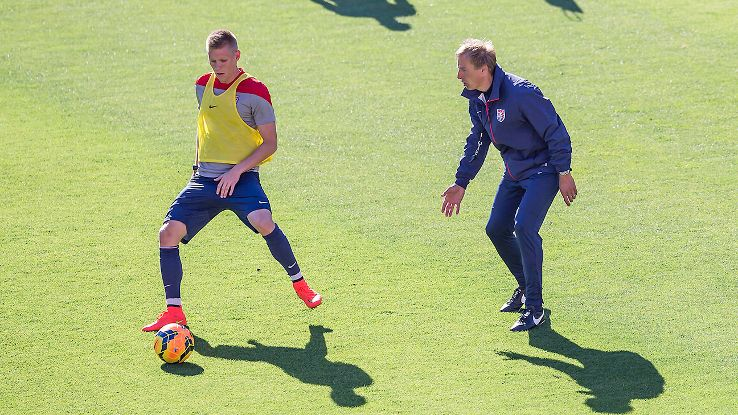 Jurgen Klinsmann shadows Aron Johannson during a practice at the U.S. pre-World Cup training camp.