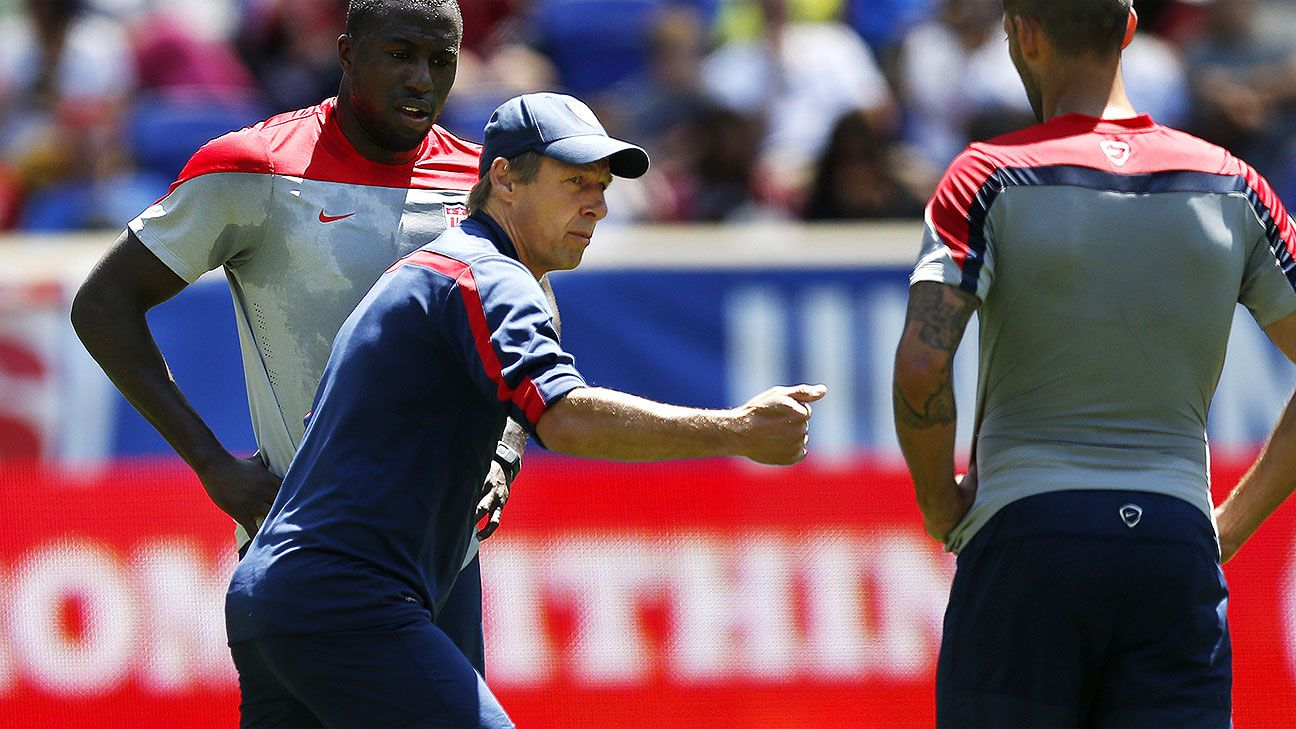 Klinsmann passes on advice to Altidore and Dempsey in a training session at Red Bull Arena.