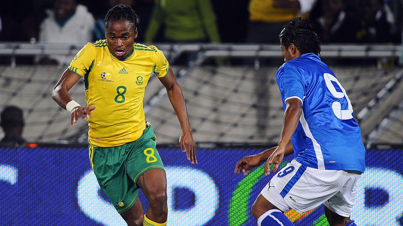 South African midfielder Siphiwe Tshabalala, left, passes Guatemalan Abner Trigueros in a pre-World Cup friendly in South Africa in 2010. This match, and four others, are at the centre of a match-fixing scandal involving referees.