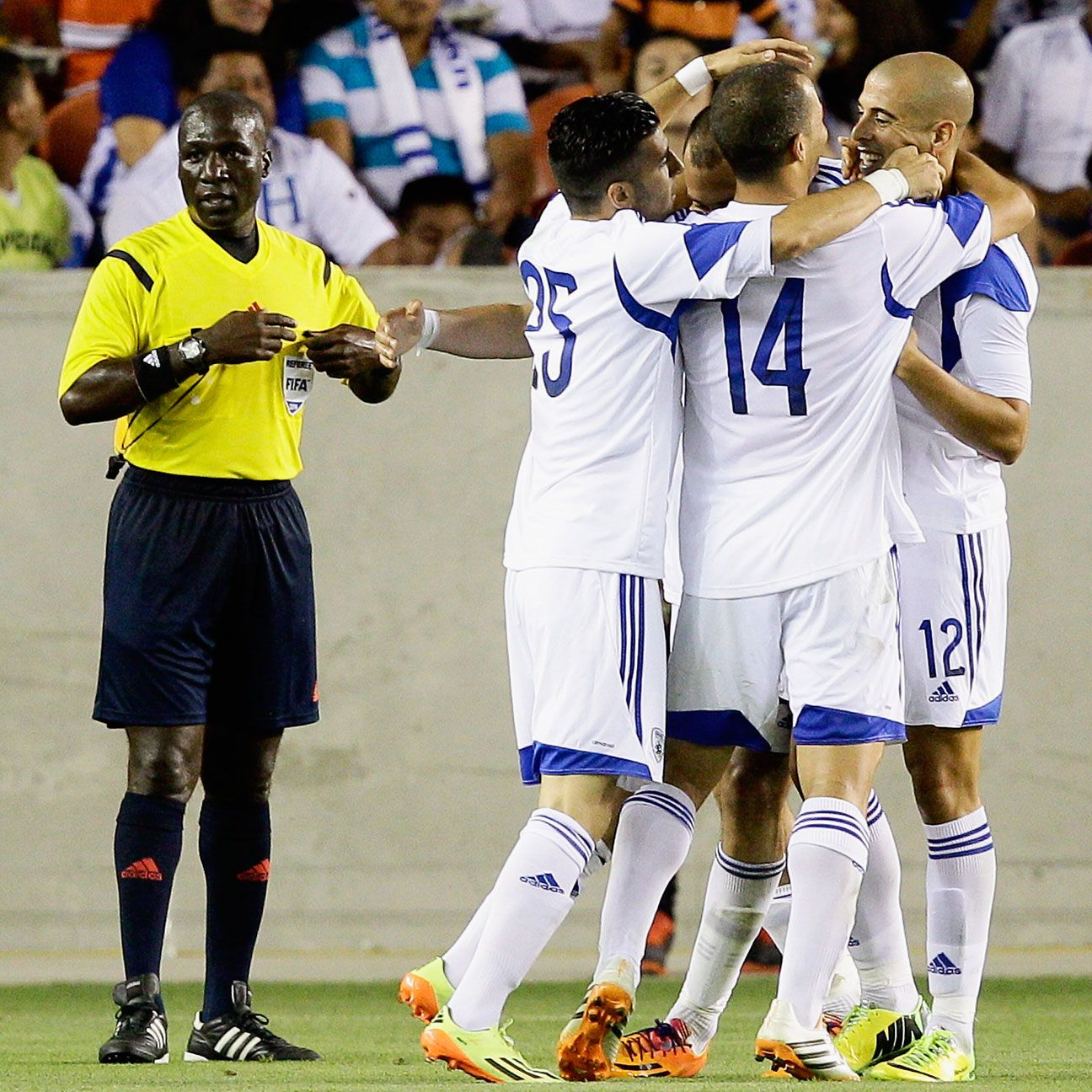 Gil Vermouth is congratulated by his teammates after wrapping up Israel's 4-2 win over Honduras.