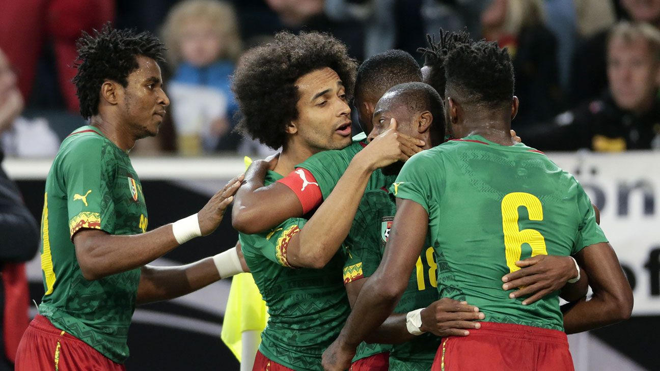 Cameroonian players rallied together to receive bonus payments.