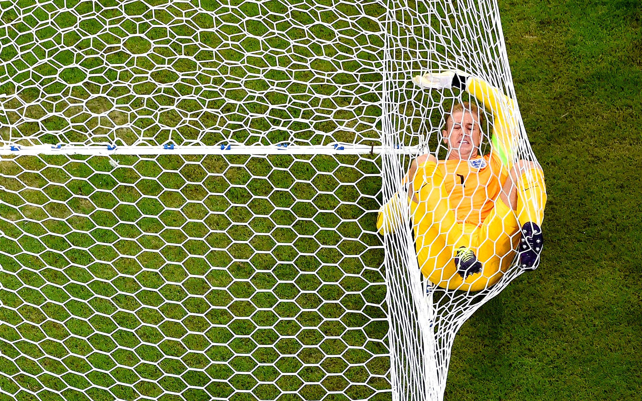 Joe Hart lands in his own net after allowing in Italy's second goal to Mario Balotelli.