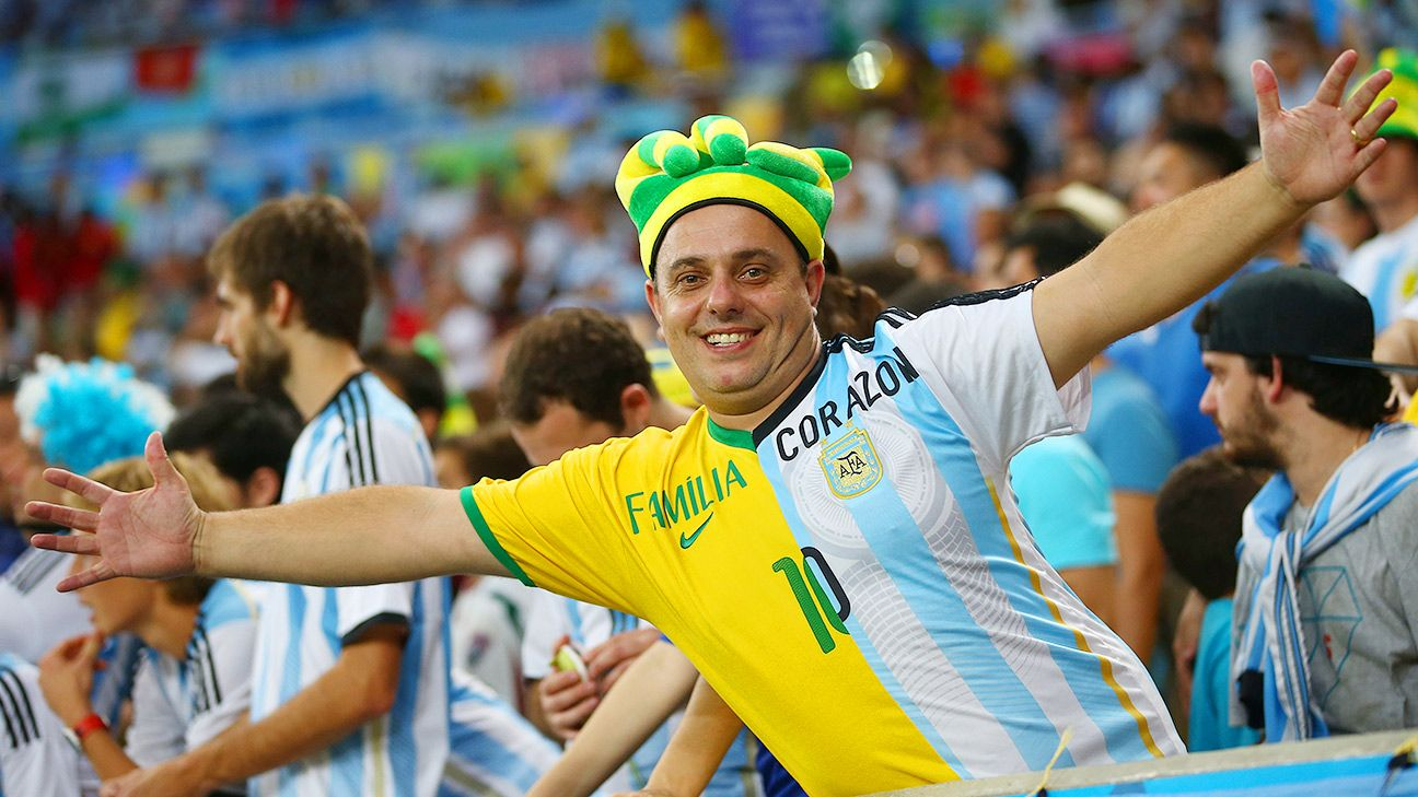 A fan wears Argentina and Brazil colors at the Maracana stadium in Rio.