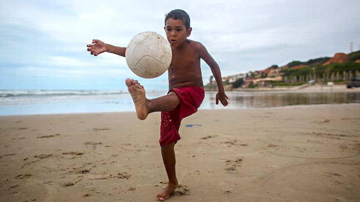 A boy plays soccer on Morro Branco beach on the outskirts of Fortaleza, which is in Brazil's 'nordeste' region.