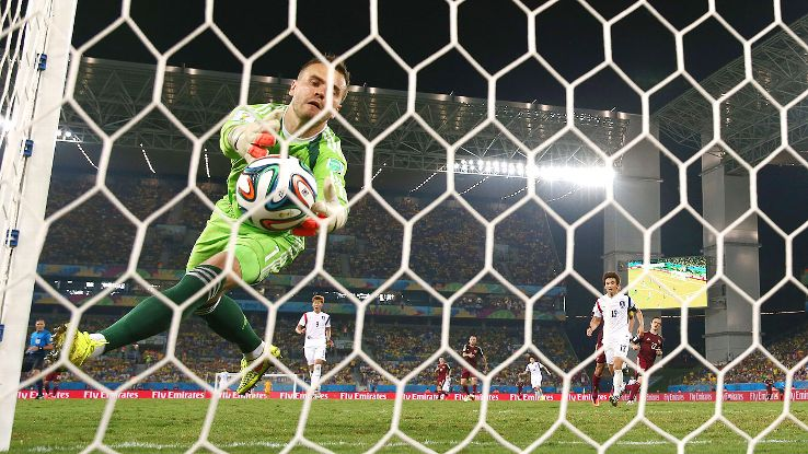 Igor Akinfeev tries desperately to keep the ball out of the net.