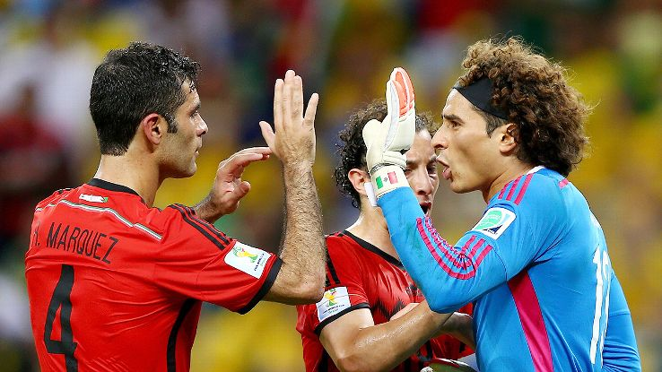 Guillermo Ochoa celebrates with Rafael Marquez, left, and Andres Guardado after one of his splendid saves.