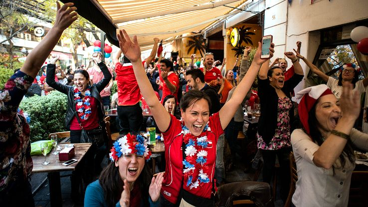 Fans in Santiago, Chile, celebrate Chile's win over Spain. The victory sends their national team to the round of 16 for the second straight World Cup.