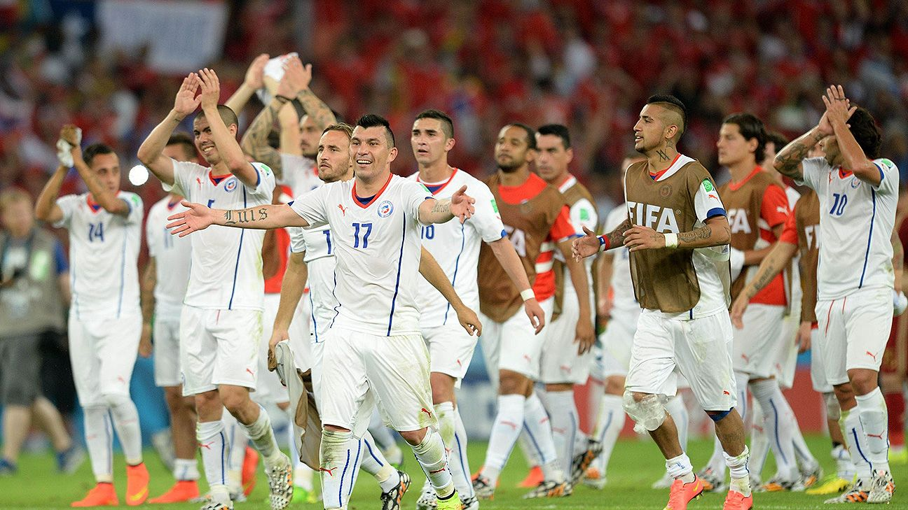 Chile charged into the second round of the World Cup with an emphatic 2-0 win over Spain on Wednesday.